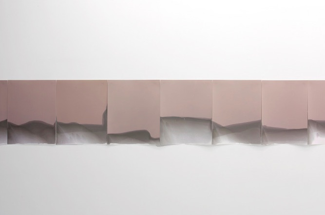 """Laurie Kang, Untitled (wall) 50 sheets unfixed and unprocessed Ilford Multigrade IV RC Deluxe paper (continually light sensitive), photographic fixative 16"""" x 800"""""""